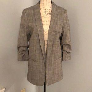 "Long length ""menswear"" blazer with pink detail."